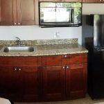 Backlot 300 room studio apt conversion, wood and granite